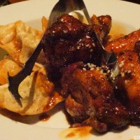 'Ohana - honey chicken wings and pork dumplings