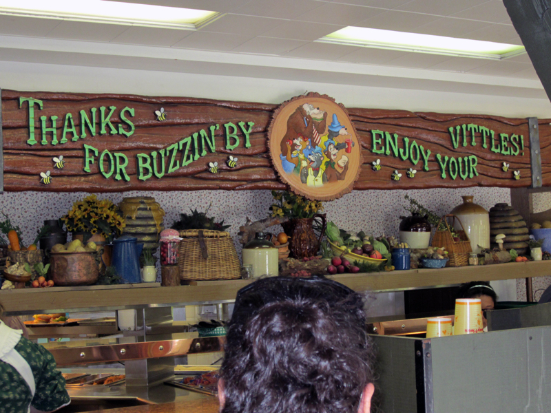 Food pick-up station decorated with a Country Bear theme