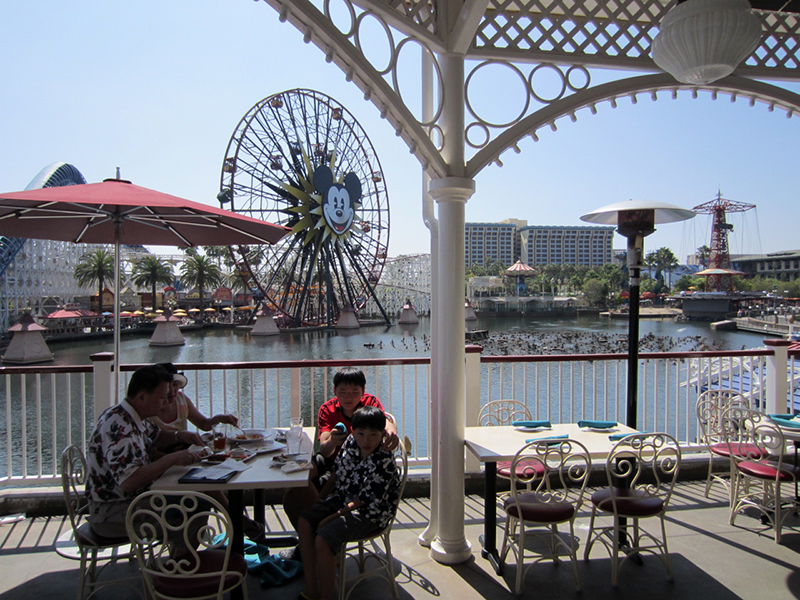 Water-side tables offer the best views of Paradise Bay and World of Color at night