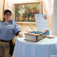 Cast Member with Eat to the Beat tickets in the Chase Lounge at the 2014 Epcot Food and Wine Festival