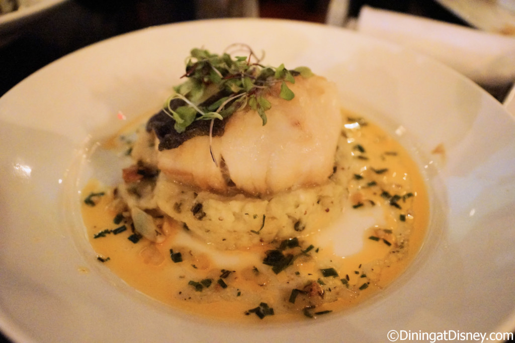 A side view of Cod Cornucopia served with a warm mustard potato salad and a chorizo vinaigrette from Raglan Road Irish Pub and Restaurant in Downtown Disney