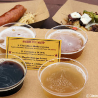Beef brisket burnt end hash with white cheddar fondue and pickled jalapenos, Debreziner sausage with house-made sauerkraut and mustard, and beer flight of Floridian Hefeweizen, Category 3 IPA, Maple Bacon Stout (Festival exclusive) and Billy's Chilies from The Smokehouse: Barbecue and Brews at the 2015 Epcot Flower and Garden Festival Outdoor Kitchens
