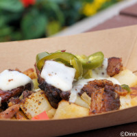 Beef Brisket Burnt Ends Hash with white cheddar fondue and pickled jalapeños from The Smokehouse: Barbecue and Brews at the 2015 Epcot Flower and Garden Festival