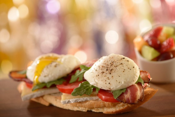 Open-faced Bacon and Poached Egg Sandwich with tomato and arugula at ...
