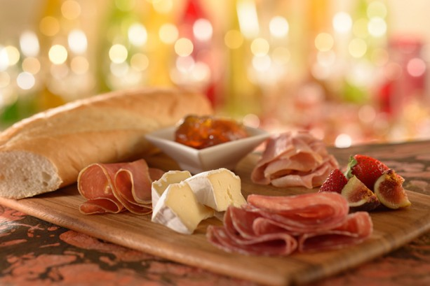 Cured meats and cheeses with a baguette at Be Our Guest Restaurant in Magic Kingdom at Disney World