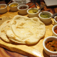 Indian style bread service includes your choice of 3 breads and 9 dipping sauces at Sanaa