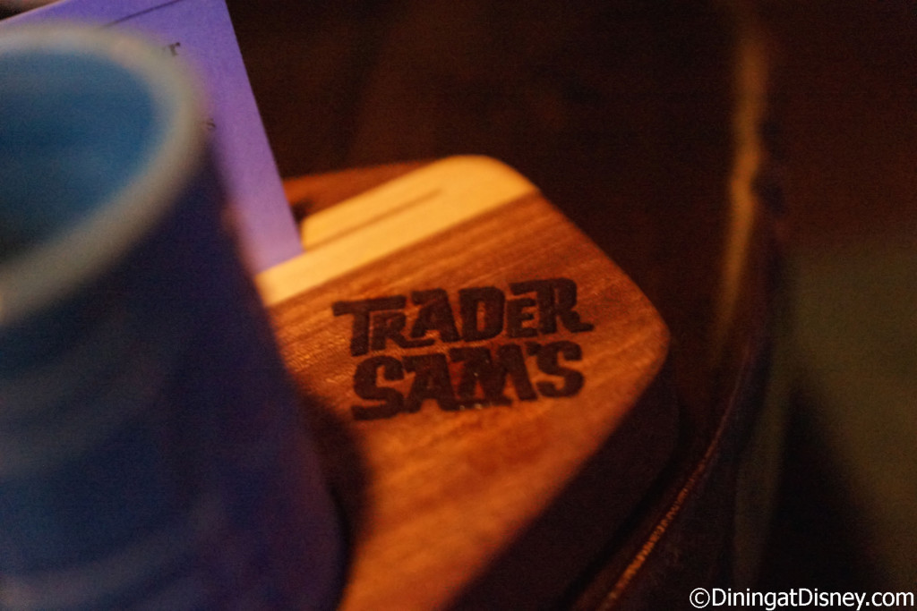 Trader Sam's stamped into the Rum Flight board at Trader Sam's Grog Grotto