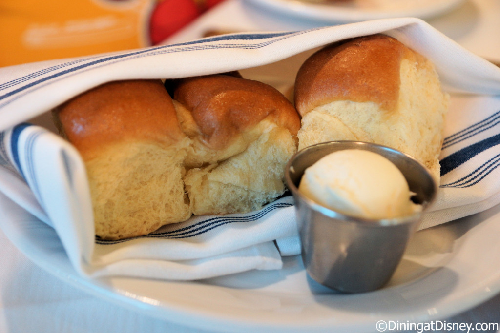 The meal starts with dinner rolls and butter at The BOATHOUSE in Disney Springs