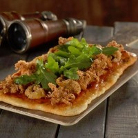 Fried Calamari Flatbread with Spicy Harissa from Jock Lindsey's Hangar Bar in Disney Springs