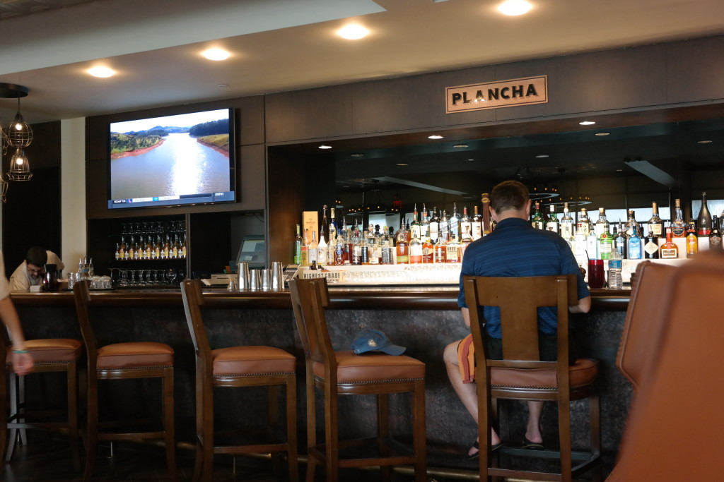 Guests can sit at the bar in Plancha and enjoy a drink while watching sports