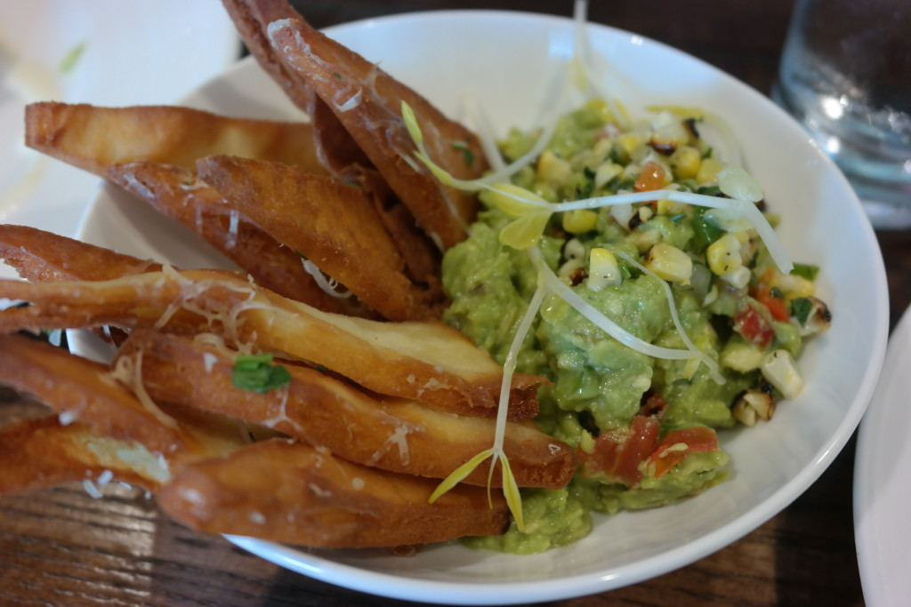 Guacamole with roasted corn relish and naan chips from Plancha at Four Seasons Orlando