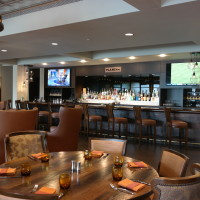 The dining room and bar at Plancha in the Four Seasons Orlando