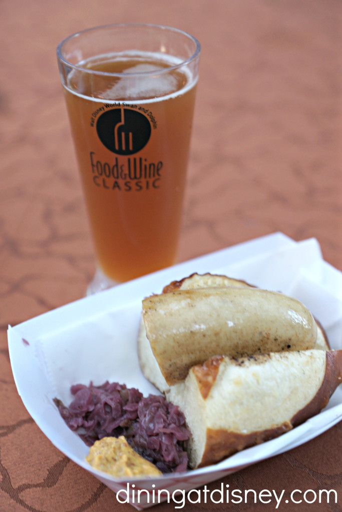 Handcrafted Germany Style Sausage on Laugen Bread with Braised Cabbage and a beer from the Beer Garden at the Swan and Dolphin Food and Wine Classic  2015