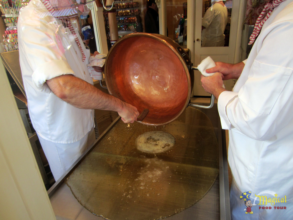 Huge copper pots are filled with a sugar and corn syrup mix