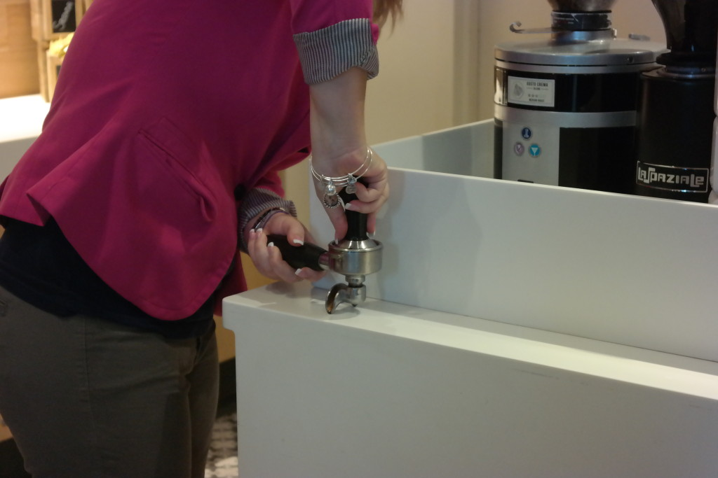 Demonstration of compacting the grind to make espresso at Lickety Split Barista Bootcamp