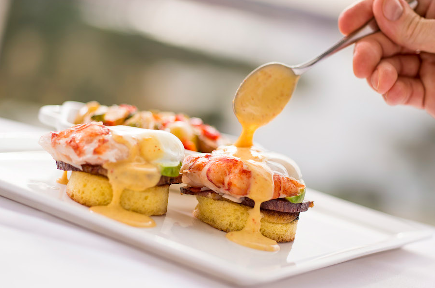 Poached Lobster Benedict with Butter-Poached Tail, Two Soft-Poached Eggs, Honey Ham, Yuzu Hollandaise, Marble Potato Hash - Sunday Brunch at California Grill