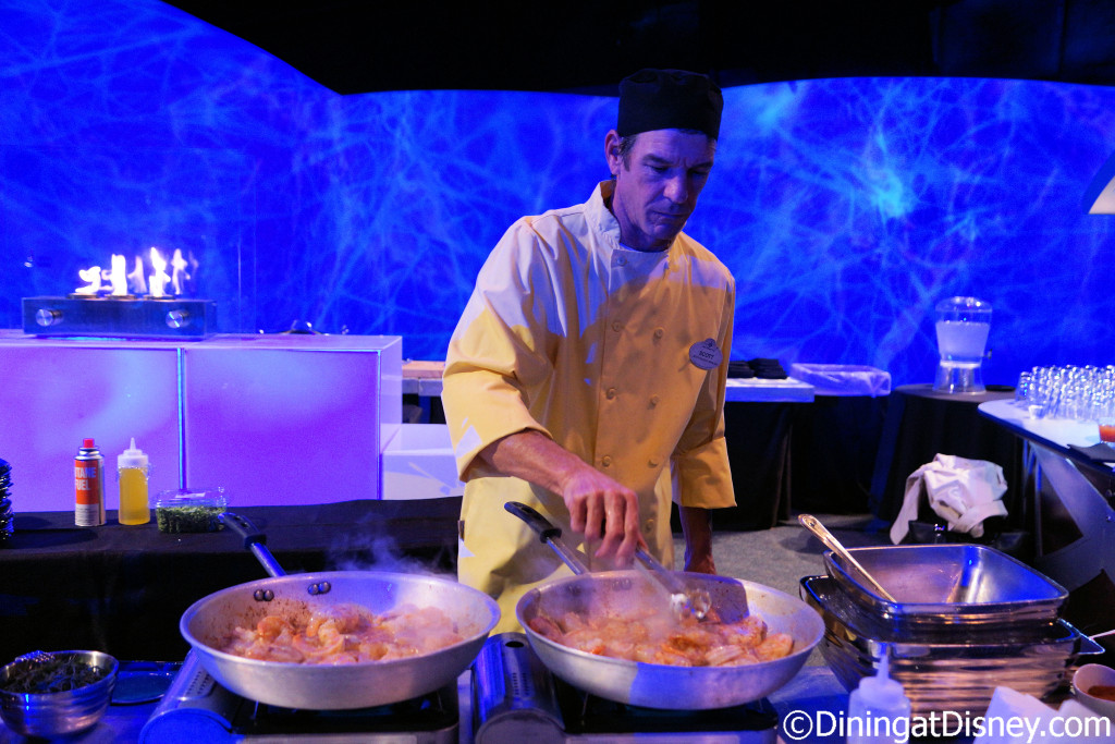 Sauteing shrimp for the Shrimp & Grits at Florida Fresh at the 2016 Epcot Flower & Garden Festival food and beverage preview