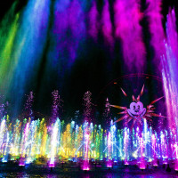 """'WORLD OF COLOR' -- Lights, water, music, fire and animation come together like never before in """"World of Color"""" at Disney California Adventure park in Anaheim, Calif. The show combines nearly 1,200 powerful fountains with heights that range from 30 feet to 200 feet in the air, dazzling colors and a kaleidoscope of audio and visual effects, including both classic and new animation projected on one of the world's largest projected water screens — a wall of water 380 feet wide by 50 feet high for a projection surface of 19,000 square feet . Presented on Paradise Bay in Disney California Adventure park, """"World of Color"""" is a major milestone in the multi-year expansion of the park. (Paul Hiffmeyer/Disneyland)"""