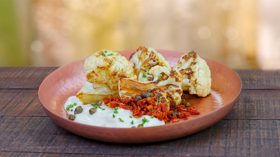 Roasted cauliflower and Meyer lemon-infused Dannon Oikos® Greek nonfat yogurt cauliflower puree with sundried tomatoes and fried capers from Lemon Grove at the 2017 Disney California Adventure Food and Wine Festival
