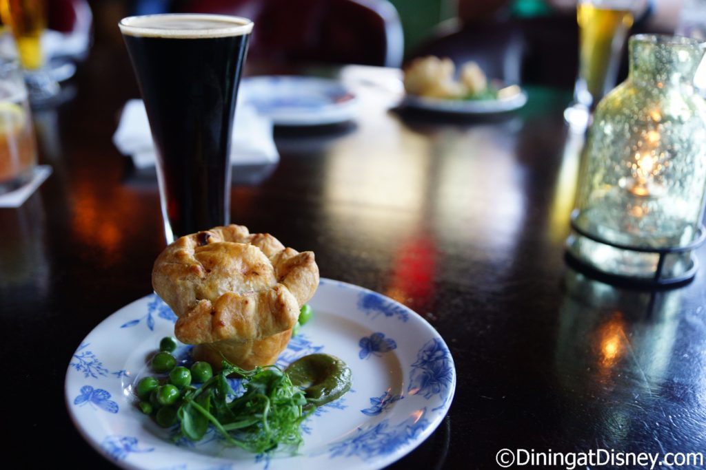 Braised Lamb Mini Pie with Minted Pea Purée paired with Tri Wishes Grand Irish Red from Crooked Can Brewing - Raglan Road Mighty St. Patrick's Festival