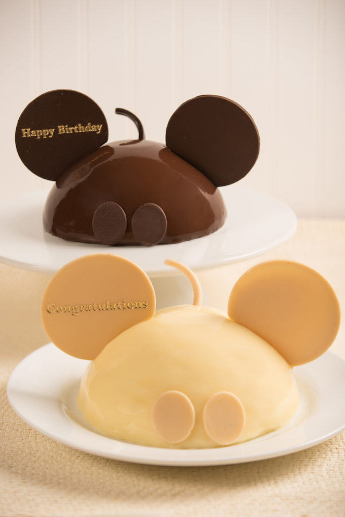 New Mickey Mouse celebration cakes come in chocolate & white chocolate