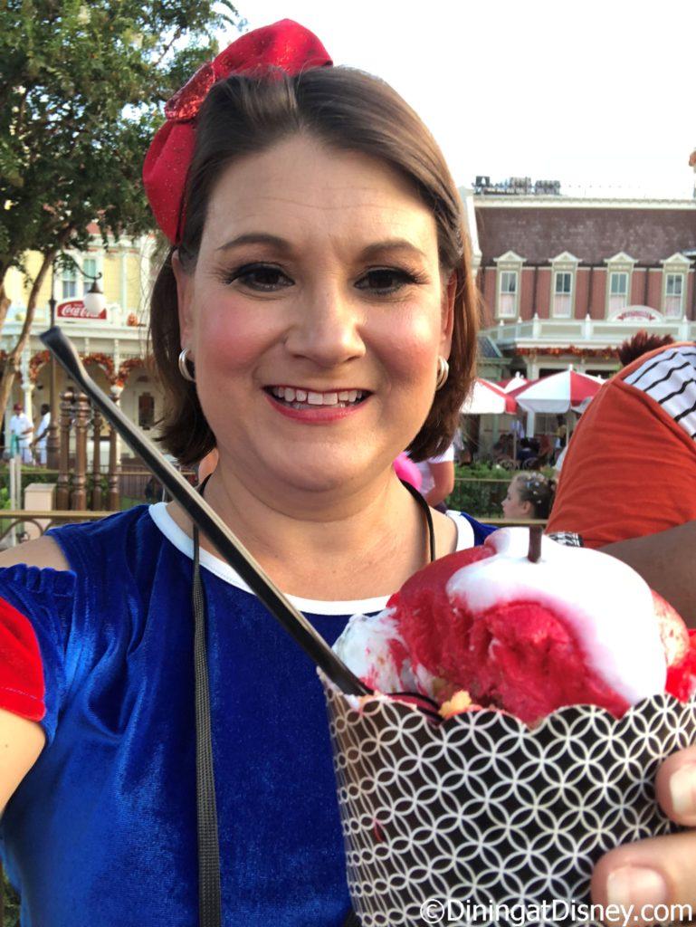 Kristen enjoying the Not-So-Poison Apple Cupcake as Snow White